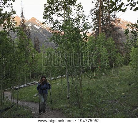 LAKE CITY, COLORADO, JUNE 21. The Silver Creek Trail on June 21, 2017, near Lake City, Colorado. A Woman Hikes the Silver Creek Trail in Colorado in Early Morning
