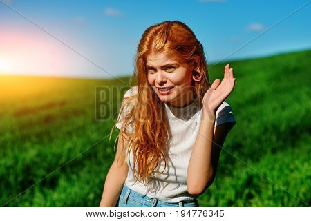 Beautiful Woman In The Nature Tries To Understand Somebody By Trying To Hear Something With Putting