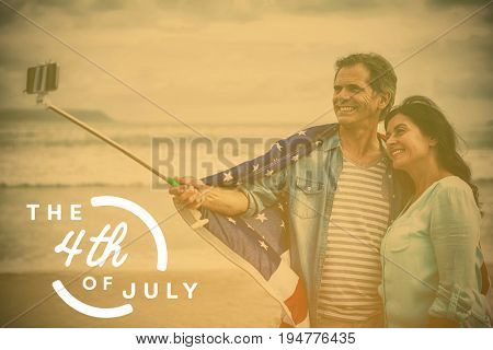 Colorful happy 4th of july text against white background against happy couple with american flag taking selfie
