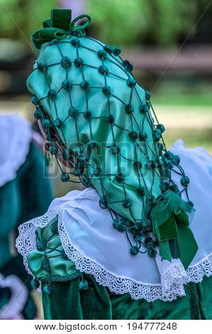 Detail of Spanish folk costume for women with lace and braids.