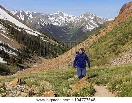 LAKE CITY, COLORADO, JUNE 21. The Silver Creek Trail on June 21, 2017, near Lake City, Colorado. A Bearded Man Hiking the Silver Creek Trail in Colorado