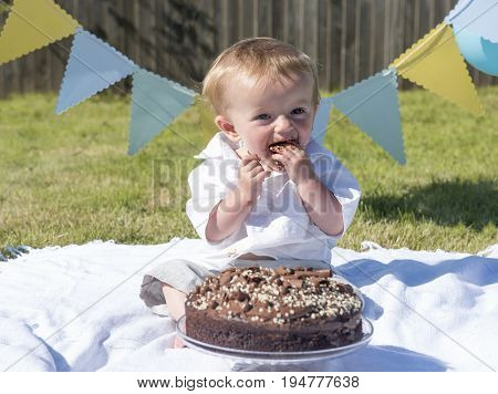 One year old baby boy chocolate cake smash