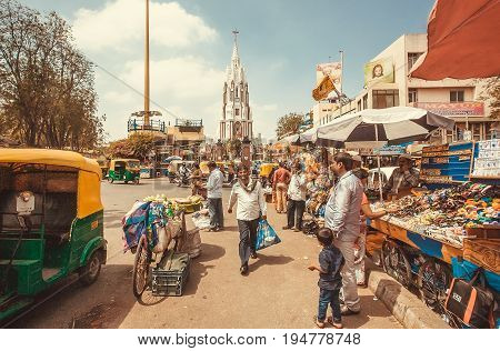 BANGALORE, INDIA - FEB 14, 2017: Market street with autos clothing stores and rushing customers on February 14, 2017. With popul. 8.52 million Bangalore is third most populous indian city