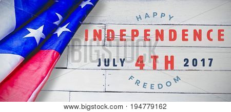 Computer graphic image of happy 4th of july text against wood panelling