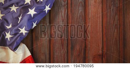 Creased US flag against wood