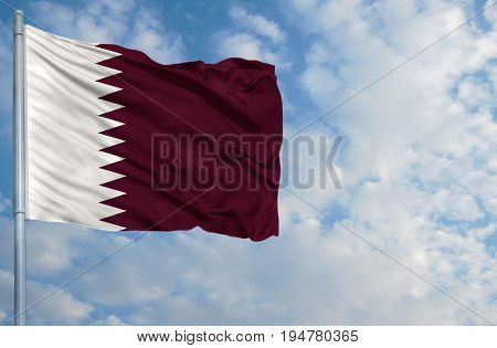 National flag of Qatar on a flagpole in front of blue sky.