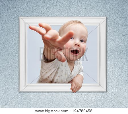 Funny picture of baby in white frame