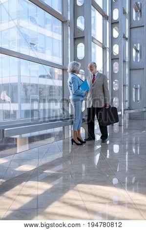 Senior business people talking in modern business center