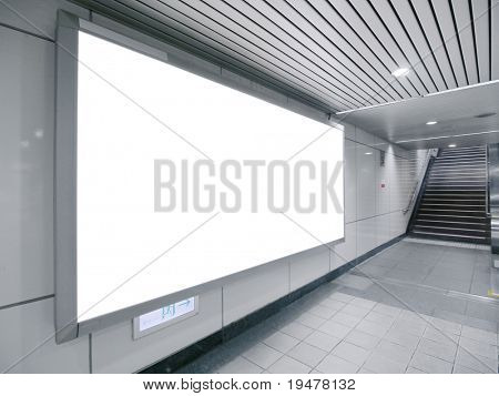 Blank billboard in underground passage to subway