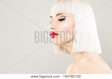 Sexy Blonde Woman Fashion Model with Colored Hair. Blondie Girl with Blonde Bob Hairdo and Makeup