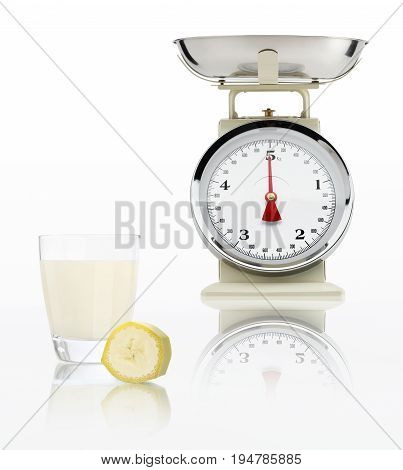 food scale with banana juice glass isolated on white background Balanced diet concept