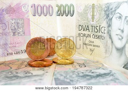 Czech coins on the various Czech banknotes money like background.