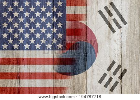Relationship between the USA and South Korea The flags of USA and South Korea merged on weathered wood