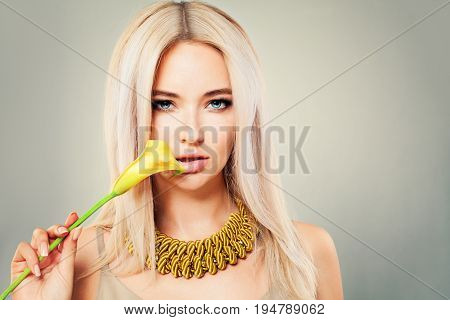 Perfect Girl with Yellow Calla Flower on gray background