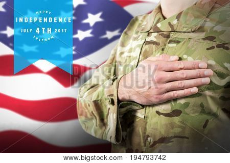 Mid section of soldier in uniform taking oath against focus on usa flag