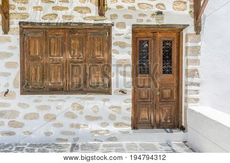 traditional wood door and window in the cyclades islands. greek