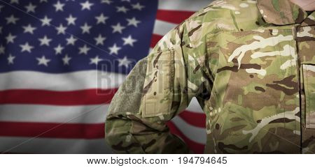 Mid section of military soldier against american flag