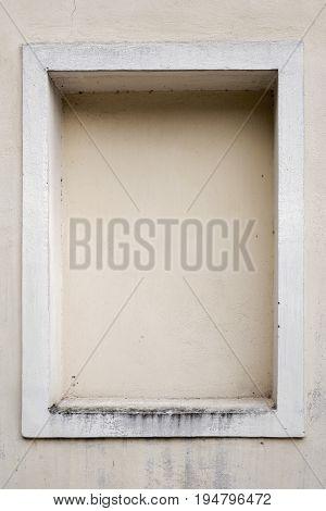 weathered dirty stucco wall with a stucco frame