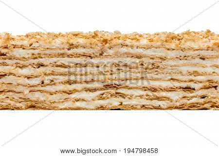 Napoleon cake texture on white background. Puff pastry butter-custard