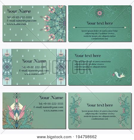 Set of six horizontal business cards. Floral pattern on vintage background. Fantasy flowers with leaves and berries. Decorative bird pecks berries. Complied with the standard sizes.