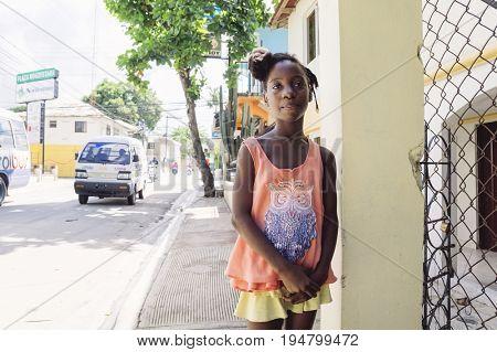 LAS TERRENAS, DOMINICAN REPUBLIC - SEPTEMBER 26, 2016: unidentified little girl posing outdoors.