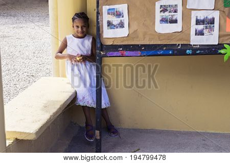 LAS TERRENAS, DOMINICAN REPUBLIC - SEPTEMBER 26, 2016: unidentified girl in the school yard. More than 40% of Dominican children are uneducated.