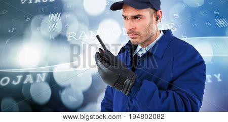 Focused security officer talking on walkie talkie  against virus background