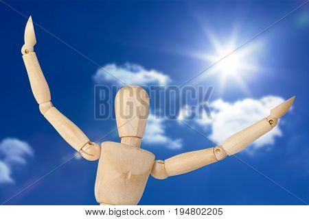 Close up of 3d figurine with arms spread wide against sky