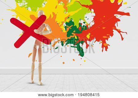 Colourful paint splashes against gray flooring and wall
