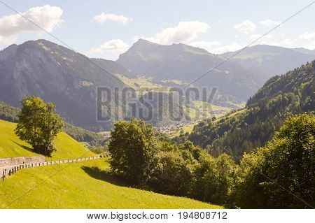 View of a valley and green hills in the Austrian Tyrol