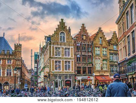 Bicycles On Markt And People Walking Along Steenstraat. View Towards Hallestraat. Bruges, Belgium