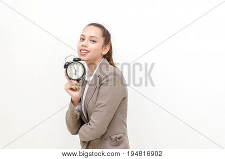 asian young business woman beautiful smile holding black vintage retro alarm clock times at 7 o'clock morning in hand working time and business concept