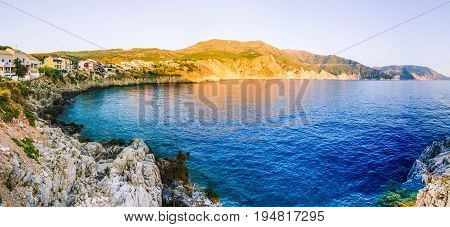 Assos village from cliffs site on evening sunset in Kefalonia, Greece.