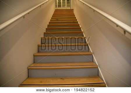 Interior house narrow wooden stairs no people