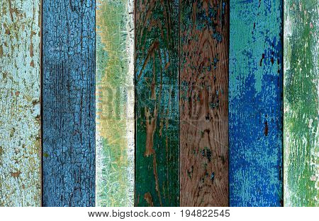 Background of Green Blue and Grey Old Cracked Wooden Board closeup