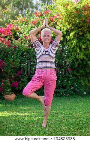 senior woman doing yoga pose