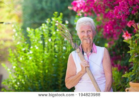active retierment, fit senior woman gardening