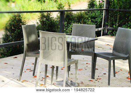 Set chairs of vintage style in garden