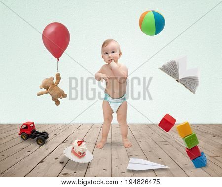 Small child staying in the room with his toys.
