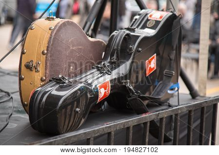 Two used guitar cases concert site stage outdoor
