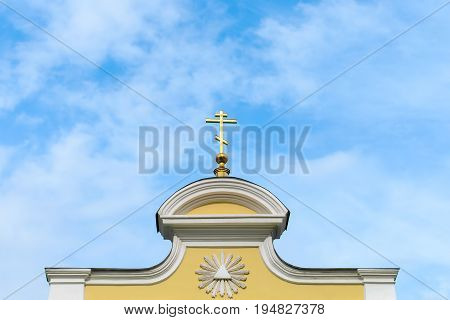 Dome and cross against the blue sky