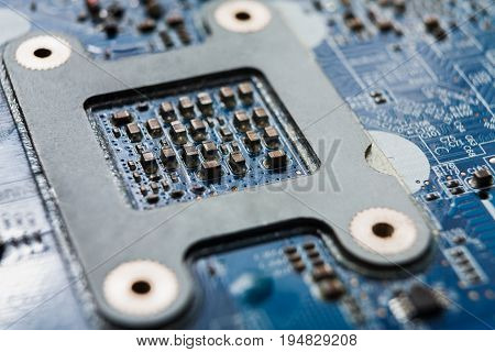 Laptop motherboard microcircuit closeup, top view. Computer electronic parts background