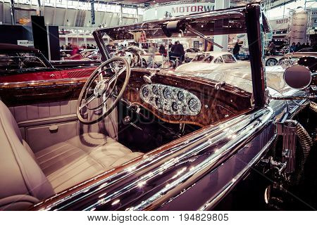 STUTTGART GERMANY - MARCH 17 2016: Cabin of full-size luxury car Mercedes-Benz 770K Cabriolet D (W07) 1931. Toning. Stylization. Europe's greatest classic car exhibition