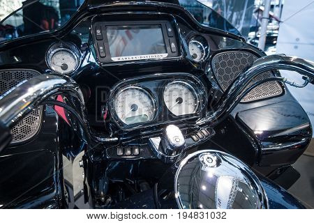 STUTTGART GERMANY - MARCH 17 2016: The dashboard of a motorcycle Harley-Davidson Road Glide 2016. Europe's greatest classic car exhibition