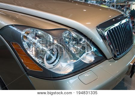 STUTTGART GERMANY - MARCH 17 2016: Headlamp of full-size luxury car Maybach 57S 2006. Europe's greatest classic car exhibition