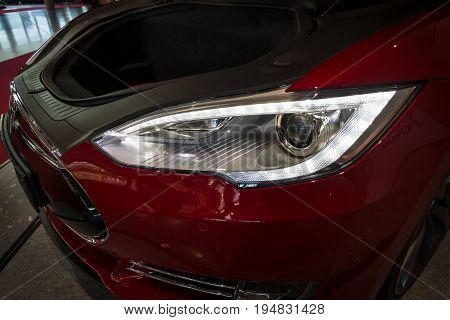 STUTTGART GERMANY - MARCH 17 2016: Headlamp and trunk of full-size luxury car Tesla Model S AWD 90D 2015. Europe's greatest classic car exhibition