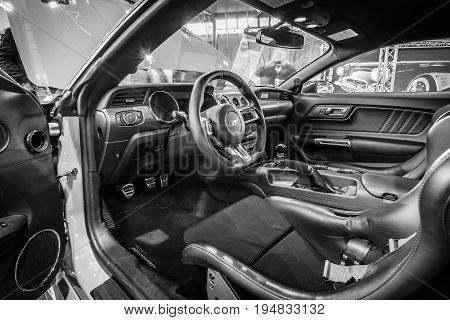 STUTTGART GERMANY - MARCH 17 2016: Cabin of pony car Ford Mustang GT fastback coupe (sixth generation) 2015. Black and white. Europe's greatest classic car exhibition