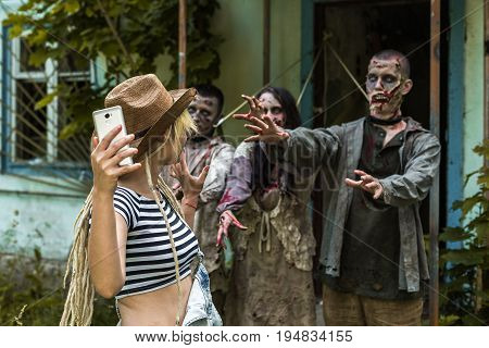 Selfie On A Background Of Zombies, Zombies Tied To An Abandoned House