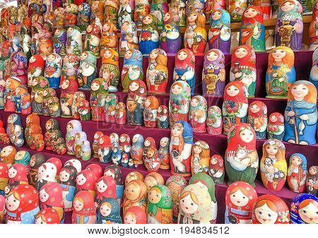 MOSCOW RUSSIA-MAY 27 2017:Beautiful colourful wooden dolls matryoshka at market. Matryoshka dolls is folks cultural symbol of Russia