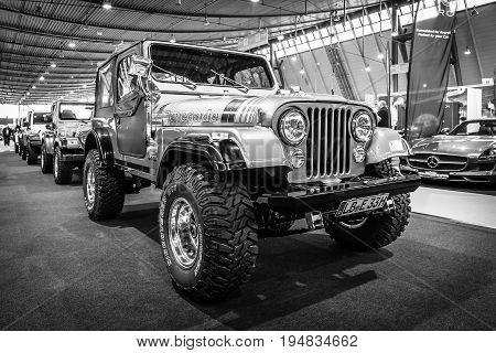 STUTTGART GERMANY - MARCH 17 2016: Off-road Jeep Wrangler Renegade 1994. Black and white. Europe's greatest classic car exhibition
